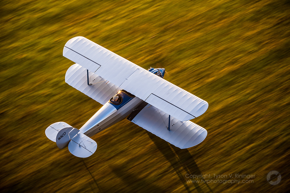 Kelly Mahon flies Mid America Flight Museum's Waco Nine over Mt. Pleasant, Texas.<br /> <br /> 1925 Waco Nine NC1536 serial number 9<br /> <br /> The Waco Nine is a tube and fabric constructed, three-seat open cockpit bi-plane built by the Advanced Aircraft Company.  The Waco Nine was the First mass-produced model with about 270 aircraft produced between 1925 and 1926.  The Waco Nine holds the Type Certificate number ATC11 and is licensed as a Standard Category aircraft. All the Waco Nine models were powered by the water cooled, Curtiss OX-5 90 HP engine turning 1,400 RPM.<br /> <br /> NC1536 was built in 1925 and is serial number 9 off the line of about 270 built. In 2000, Frank Pavliga started what turned out to be a 14 year restoration of this magnificent piece of American History. Forrest Barber made the first flight on Friday, April 13, 2012. <br /> <br /> The aircraft restoration is considered by most that have seen it to be a perfect &ldquo;10&rdquo;. Frank made every effort to keep the aircraft 100% original down to the steerable tailskid and no brakes! There are estimated to be 10-15 Waco Nine airframes scattered around including several in museums, but it is believed that this is the only flyable example remaining.  <br /> <br /> Waco Nine Aircraft Specifications:<br /> 1 Pilot / 2 Passengers<br /> Length:  23 ft 4 in<br /> Wingspan: 29 ft 6 in<br /> Maximum Speed: 92 mph<br /> Crusie Speed: About 65 mph<br /> Stall Speed:  32 mph<br /> Range: About 300 Miles