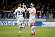 Wycombe defender Jason McCarthy (26) celebrates his goal with Wycombe midfielder Matthew Bloomfield (10) during the EFL Sky Bet League 1 match between Peterborough United and Wycombe Wanderers at London Road, Peterborough, England on 2 March 2019.