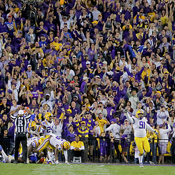 Oct 12, 2019; Baton Rouge, LA, USA; LSU Tigers defensive lineman Breiden Fehoko (91) celebrates after a turnover on down during the fourth quarter against the Florida Gators at Tiger Stadium. Mandatory Credit: Derick E. Hingle-USA TODAY Sports