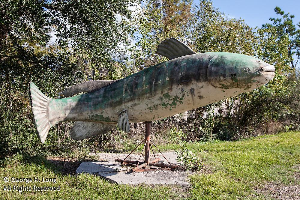 Decaying catfish sculpture sign for Kelly's Katfish Korner restaurant on Highway 433, Bayou Liberty Road