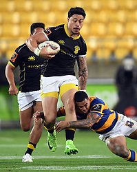Wellington's Ben Lam slips the tackle of Bay of Plenty's Monty Ioane in the Mitre 10 Rugby Final match at Westpac Stadium, Wellington, New Zealand, Friday, October 27, 2017. Credit:SNPA / Ross Setford  **NO ARCHIVING**