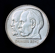 Gottlieb Wilhelm Daimer (1834-1900), left, and arl Friedrich Benz 1844-1929) from a medal commemorating 75 years of motoring.