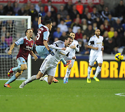 Swansea City's Michu is fouled by West Ham United's Ravel Morrison - Photo mandatory by-line: Joe Meredith/JMP - Tel: Mobile: 07966 386802 27/10/2013 - SPORT - FOOTBALL - Liberty Stadium - Swansea - Swansea City v West Ham United - Barclays Premier League