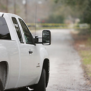 A truck is stopped by caution tape on Ashley Circle  in Wilmington, N.C. Thursday February 13, 2014. The area saw two days of freezing rain that caused a loss of power for much of New Hanover, Pender, and Brunswick counties.   (Jason A. Frizzelle)