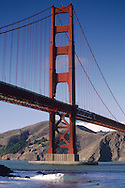 Surfers below the North Tower of the Golden Gate Bridge, San Francisco, California
