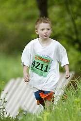 "(Kingston, Ontario---16/05/09) ""Padraig Macdougall running in the kids race at the 2009 Salomon 5 Peaks Trail Running series Race held in Kingston, Ontario as part of the Eastern Ontario/Quebec division. ""  Copyright photograph Sean Burges / Mundo Sport Images, 2009. www.mundosportimages.com / www.msievents.com."
