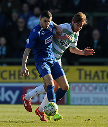 Oldham Athletic's James Wilson is tackled by Yeovil Town's Sam Foley - Photo mandatory by-line: Harry Trump/JMP - Mobile: 07966 386802 - 07/03/15 - SPORT - Football - Sky Bet League One - Yeovil Town v Oldham Athletic - Huish Park, Yeovil, England.