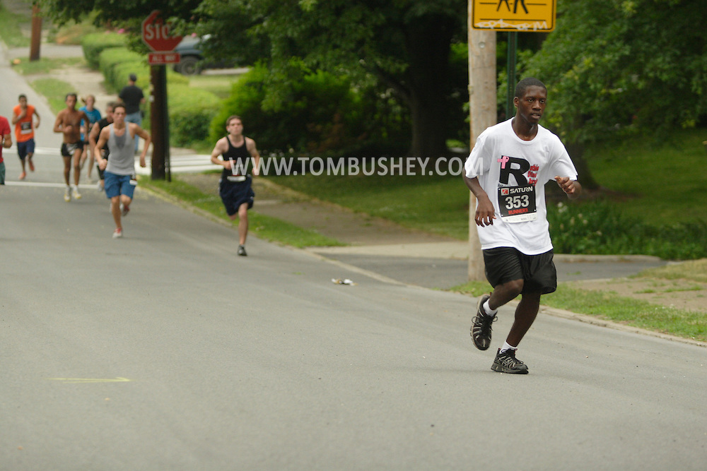 Middletown, NY -  Runners race in the Ruthie Dino-Marshall 5K Run on June 3, 2007.