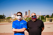 01 AUGUST 2020 - DES MOINES, IOWA: Men wearing face masks watch a group of doctors at the Iowa State Capitol Saturday. About 50 doctors, medical professionals, and public health professionals from across Iowa came to the State Capitol to demand that Iowa Governor Kim Reynolds impose a mask mandate to control the spread of the coronavirus (SARS-CoV-2). Despite the continued spread of the coronavirus and rapidly increasing infection rate for COVID-19, the Governor has refused to impose a mask mandate or close businesses. For the week ending Saturday, Aug. 1, Iowa reported new 2,736 new cases of COVID-19.            PHOTO BY JACK KURTZ
