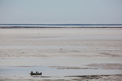 Fishing on a low spring tide in Dampier Creek, Roebuck Bay, Broome.