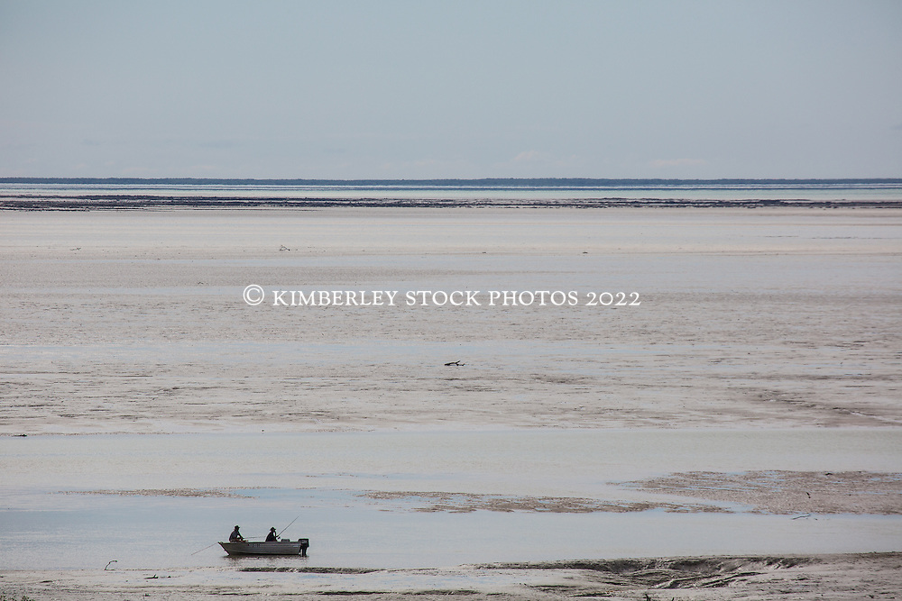 Fishing on a low spring tide in Dampier Creek, Roebuck Bay, Broome.