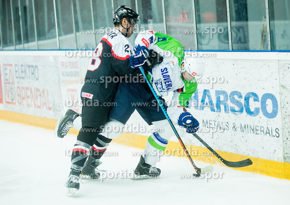 Takuro Yamashita of Japan vs Ziga Pance of Slovenia during ice-hockey friendly match between National teams of Slovenia and Japan, on April 10, 2015 in Arena Podmezakla, Jesenice, Slovenia. Photo by Vid Ponikvar / Sportida