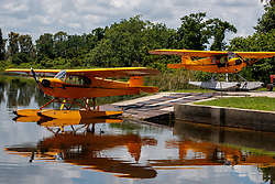 1940 Piper J3C-65 Cub (N32768) and Piper J3C-65 Cub (N3470K) on the ramp at Jack Brown's Seaplane Base (F57), Winter Haven, Florida, United States of America