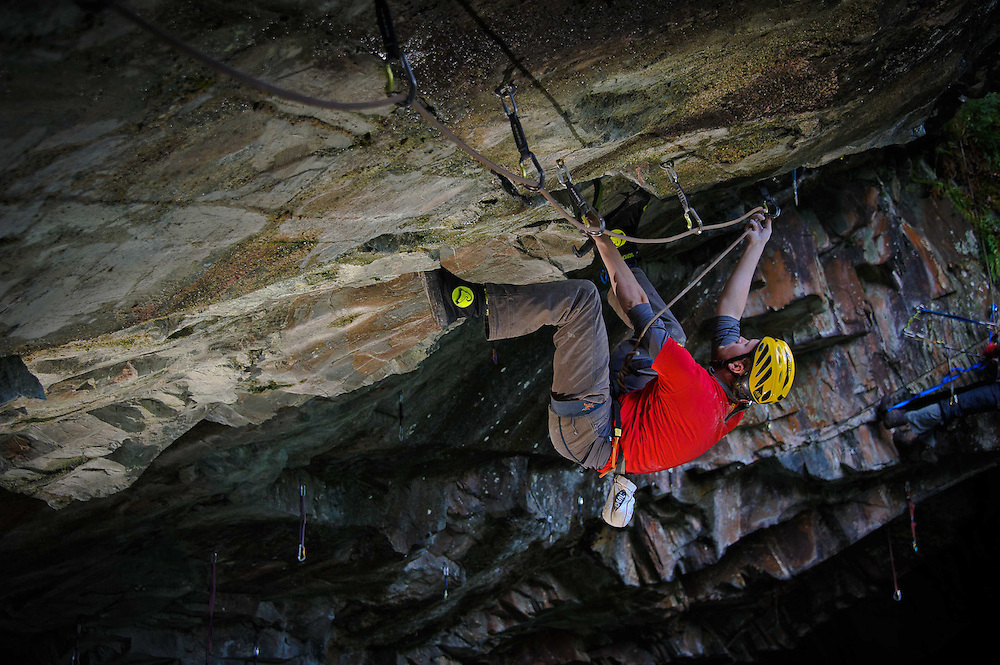 "Simon Chevis attempting an ascent of the hard dry tooling route ""Blood Line""at Hodge Close Quarry, Lake District, UK"