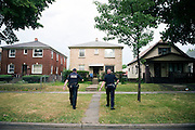 MILWAUKEE, WI-JULY 21, 2016: Officers Michael Walker, 39, left, and officer Nathan Smalkoski, 31, walk towards a home that reported a stolen vehicle in District 5 of Milwaukee, WI, Thursday, July 21, 2016.<br /> <br /> Lauren Justice for The New York Times