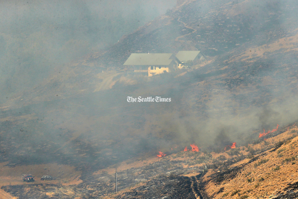 Wildfire threatens a home in Twisp Thursday August 20, 2015. <br /> <br /> Bettina Hansen / The Seattle Times