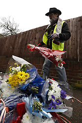 © Licensed to London News Pictures. 11/04/2018. London, UK. A man who have his name as Ian Gordon removes floral tributes from near the house of Richard Osborn-Brooks. Henry Vincent was killed as he burgled the home of 78 year old Richard Osborn-Brooks. Mr Osborn-Brooks was arrested for murder but later released without charge. Friends and family of Henry Vincent have had floral tributes they placed near the scene repeatedly torn down by locals. Photo credit: Peter Macdiarmid/LNP