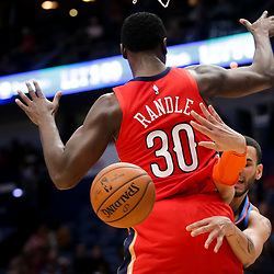 Feb 14, 2019; New Orleans, LA, USA; Oklahoma City Thunder forward Abdel Nader (11) passes around the back of New Orleans Pelicans center Julius Randle (30) during the first quarter at the Smoothie King Center. Mandatory Credit: Derick E. Hingle-USA TODAY Sports