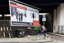 © Licensed to London News Pictures. 23/05/2016. LONDON, UK.  A billboard located opposite the Jack the Ripper museum in Cable Street, Tower Hamlets, advertises a new pop-up museum, 'East-End Women: The Real Story'. Following and opposition and protests against the controversial Jack the Ripper museum, which had promised to celebrate east end women, but activists opposed and claimed glorified violence against women, the museum is a response by the East End Women's Collective, with funding from 38 Degrees members, which aims to celebrate east end women who have stood up for women's rights and against violence. The museum will open at St George-in-the-East church from 26th May to 9th July.  Photo credit: Vickie Flores/LNP