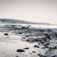 Photo of Orange County California shoreline at Crystal Cove in black and white.  Crystal Cove State Park is located along the Pacific Ocean in Laguna Beach and Newport Beach in Southern California.