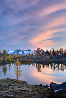 Clouds in evening afterglow over the Truce Group and tarn in Monica Meadows, Purcell Mountains British Columbia
