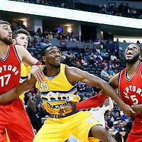 18 November 2016: Denver Nuggets forward Kenneth Faried (35) vies for the rebound with Toronto Raptors center Jonas Valanciunas (17) and Toronto Raptors forward DeMarre Carroll (5) during the Toronto Raptors 113-111 OT victory over the Denver Nuggets, at the Pepsi Center, Denver, Colorado, USA.