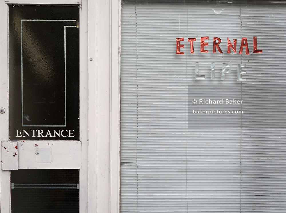 The words Eternal Life in the window of a community church on the Old Kent Road, on 16th November 2017, in London, England.