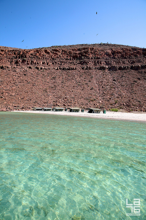 Isla Esp&iacute;ritu Santo (Espiritu Santo Island) is a large (102 km2) island surrounded by a set of smaller islets known as Isla Partida, Los Islotes, La Ballena, El Gallo and La Gallina. It lies some 20 km east of La Paz in Baja California Sur, Mexico. Because of its proximity to La Paz Bay, the island has been intensely used in the past and is still the most heavily visited island in the Sea of Cort&eacute;s. It is littered with evidence of pre-Hispanic occupancy by the Peric&uacute; people. In the 19th century Don Gast&oacute;n Viv&eacute;s established the first pearl oyster farm in the world here.<br /> The island is uninhabited, but has a luxury eco camp in one of the bays from May to October. There is no internet or phone connection (a paradise!). Around the Espiritu Santo Island you can kayak, snorkel, catch fish, swim with sea lions, watch the colonies of dolphins swim by, enjoy romantic starry nights and more...