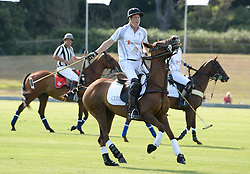 HRH PRINCE HARRY OF WALES (white no 1 shirt) at the Audi Polo Challenge 2013 at Coworth Park Polo Club, Berkshire on 3rd August 2013.