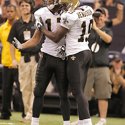2008 September 28: New Orleans Saints wide receiver Devery Henderson (19) congratulates teammate Robert Meachem (17) after making a 52-yard catch in the third quarter of the NFL week four game between the San Francisco 49ers and the New Orleans Saints at the Louisiana Superdome in New Orleans, LA.