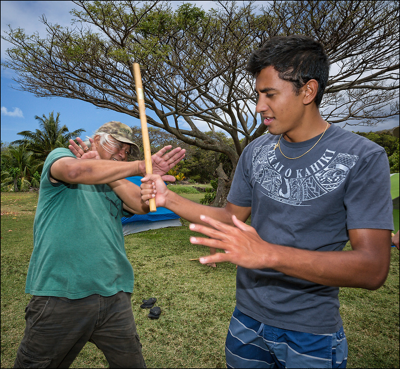 Brother Nolan teaches Kai Kahoaliki Fonseca self defense moves during Hawaiian martial arts (Ku'ialua also called Lua) training.