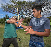 Brother Nolan teaches Kai Kahoaliki Fonseca self defense moves during Hawaiian martial arts (Ku'ialua also called Lua) training.