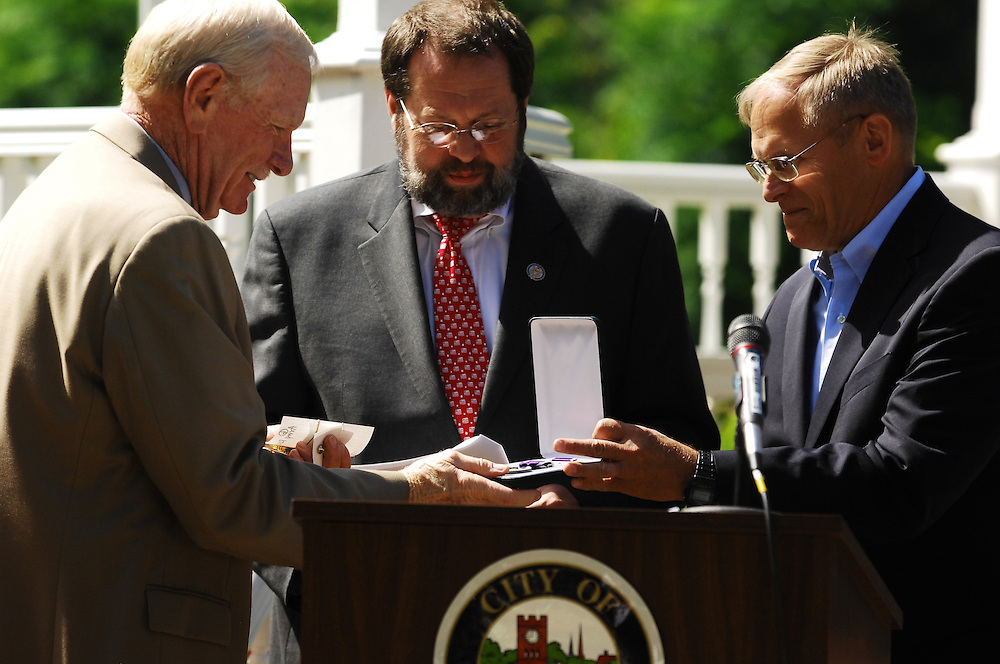 Sgt. David Hack, 71, of Hudson, receives a purple Heart from Congressman David LaTourette and retired 3-star Army General Robert Wagner - 43 years after being injured in combat.
