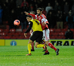 Watford's Troy Deeney holds off Bristol City's Liam Fontaine - Photo mandatory by-line: Dougie Allward/JMP - Tel: Mobile: 07966 386802 14/01/2014 - SPORT - FOOTBALL - Vicarage Road - Watford - Watford v Bristol City - FA Cup - Third Round - replay