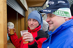 Fans drinking wine during Normal Hill Individual Competition at FIS World Cup Ski jumping Ladies Ljubno 2012, on February 11, 2012 in Ljubno ob Savinji, Slovenia. (Photo By Vid Ponikvar / Sportida.com)