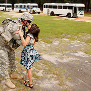 "Chief Warrant Officer 4 Tony Moschella of Lodi, California kisses his daughter Sarah Moschella  goodbye after the 316th Expeditionary Sustainment Command deployment ceremony at Pikes Field, Fort Bragg, N.C. on July 2nd, 2007 as busses wait to take him away...""Goodbye Kiss"""