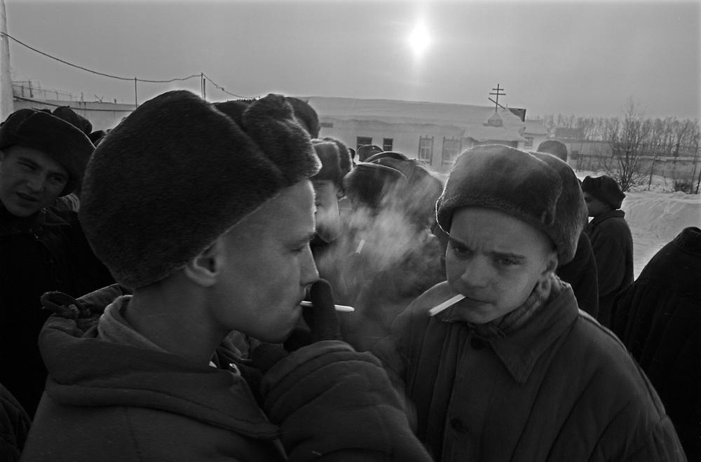 The prisoners smoke cigarettes during morning stroll at the colony for prisoner's children in Siberian town Leninsk-Kuznetsky, Russia, 26 January 2000.