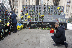 November 21, 2018 - Kiev, Ukraine - Ukrainians lay flowers at the memorial for the killed EuroMaidan activists during marking the 5th anniversary of the Euromaidan Revolution in Kiev, Ukraine, on 21 November 2018. Euromaidan Revolution or Revolution of Dignity was a wave of demonstrations and civil unrest in Ukraine, which began on the night of 21 November 2013 with public protests at Independence Square in Kiev, demanding European integration.The protests led to the 2013-2014 Ukrainian revolution and the ouster of President Viktor Yanukovych. (Credit Image: © Serg Glovny/ZUMA Wire)
