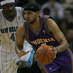 Feb 01, 2010; New Orleans, LA, USA; Phoenix Suns forward Jared Dudley (3) drives past New Orleans Hornets forward James Posey (41) during the first half at the New Orleans Arena. Mandatory Credit: Derick E. Hingle-US PRESSWIRE