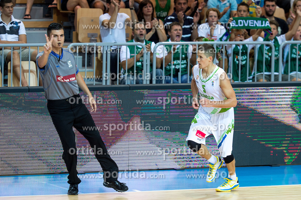 Jaka Lakovic of Slovenia celebrates after scoring three point shot during friendly match between National teams of Slovenia and Montenegro for Eurobasket 2013 on August 23, 2013 in Arena Bonifika, Koper, Slovenia. (Photo by Matic Klansek Velej / Sportida.com)
