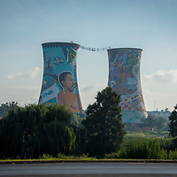 The Orlando Power Station is a decommissioned coal-fired power plant in Soweto, South Africa.  The cooling towers were painted for the 2010 FIFA World Cup.  The cooling towers are now a tourist destination where you can pay to ride a power swing between the two towers or jump inside one from the 300 foot top rim.