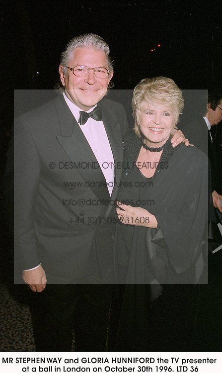 MR STEPHEN WAY and GLORIA HUNNIFORD the TV presenter at a ball in London on October 30th 1996.LTD 36