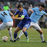 Fernando Torres, Chelsea, is tackled by Javi Garcia, (left), and Gareth Barry, Manchester City, during the Manchester City V Chelsea friendly exhibition match at Yankee Stadium, The Bronx, New York. Manchester City won the match 5-3. New York. USA. 25th May 2012. Photo Tim Clayton
