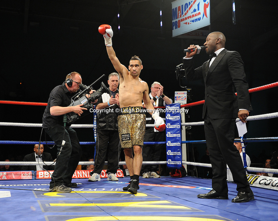 Akaash Bhatia's name is announced by MC at English Super Featherweight Title at Medway Park, Gillingham, Kent, UK on 13th May 2011. He later is defeated by Ben Jones. Frank Maloney Promotions. Photo credit © Leigh Dawney 2011.