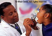 Doctor, Physician at Work, African American Physician and Black Child Patient