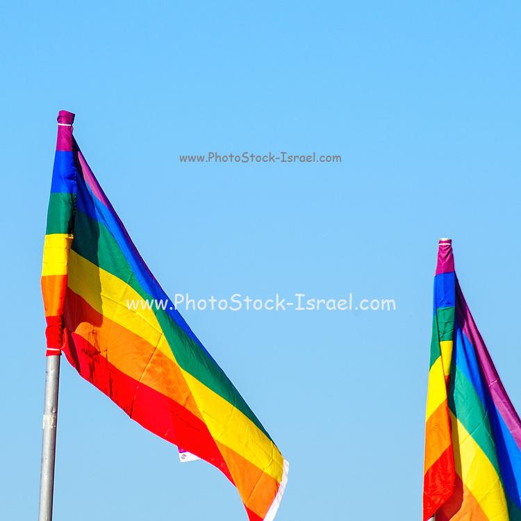 Gay rainbow flag with a blue sky background
