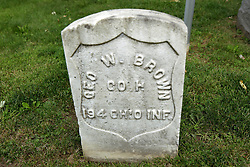 26 August 2017:   A part of the History of McLean County Illinois.<br /> <br /> Tombstones in Evergreen Memorial Cemetery.  Civic leaders, soldiers, and other prominent people are featured. Section 5, the old town soldiers area<br /> Geo. W Brown  Co H  194 OHIO INF
