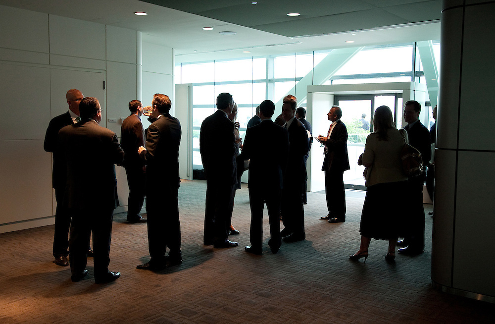 Group of people full length stand silhouetted during business cocktail reception