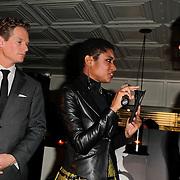 NLD/Amsterdam/20120201 - Lancering LG Prada, Sylvana Simons en partner Ronald Kahn
