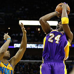 February 5, 2011; New Orleans, LA, USA; Los Angeles Lakers shooting guard Kobe Bryant (24) shoots over New Orleans Hornets shooting guard Willie Green (33) during the third quarter at the New Orleans Arena. The Lakers defeated the Hornets 101-95.  Mandatory Credit: Derick E. Hingle